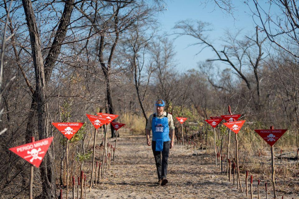 The Duke of Sussex walks through a minefield in Dirico, Angola,