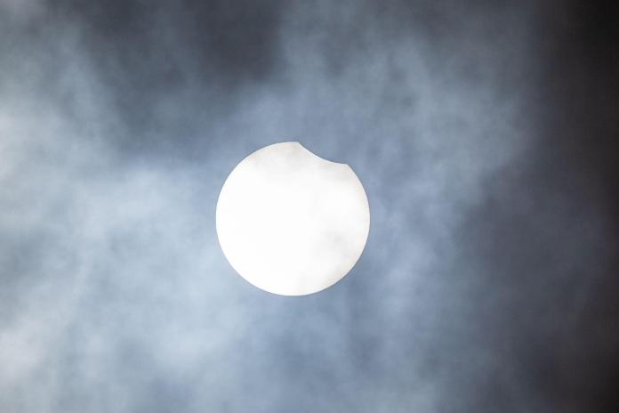 Partial solar eclipse begins over Birmingham in Britain
