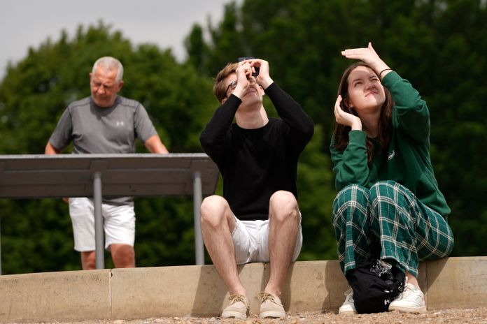 Viewers of the eclipse on Primrose Hill in London