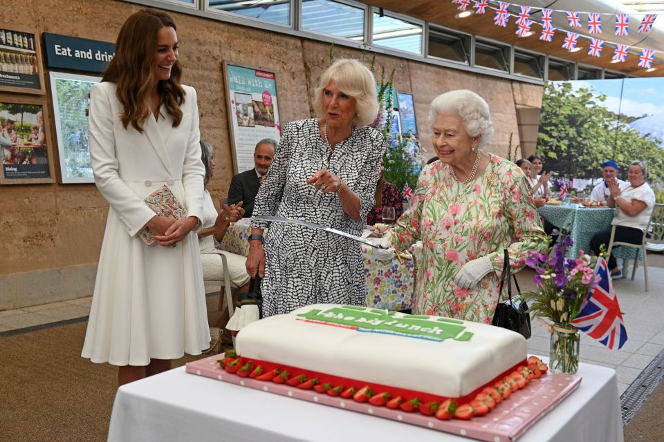 Her Majesty made Kate and Camilla giggle as she opted for her sword to cut a cake at a royal engagement - declaring it 'more unusual' than a knife