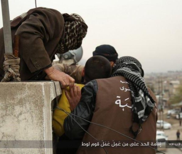 ISIS militants prepare to toss a gay man from a rooftop during their reign in Raqqa
