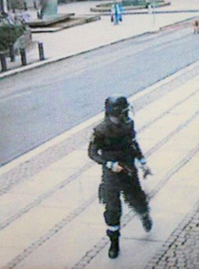 A surveillance camera caught Breivik, dressed in police uniform and carrying a pistol, as he walks away from a car after placing a bomb in Oslo