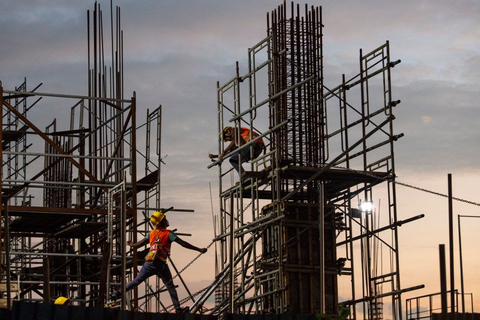 Chinese workers are creating a site of tall glass skyscrapers in Colombo, Sri Lanka
