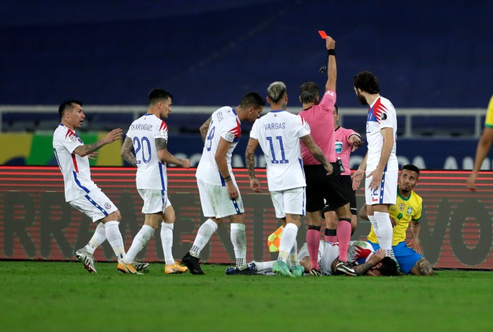 The Chile players were furious with the 'karate kick' from the Brazil forward