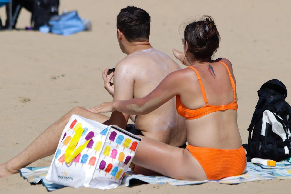 A couple dig out the sunscreen in East Sussex