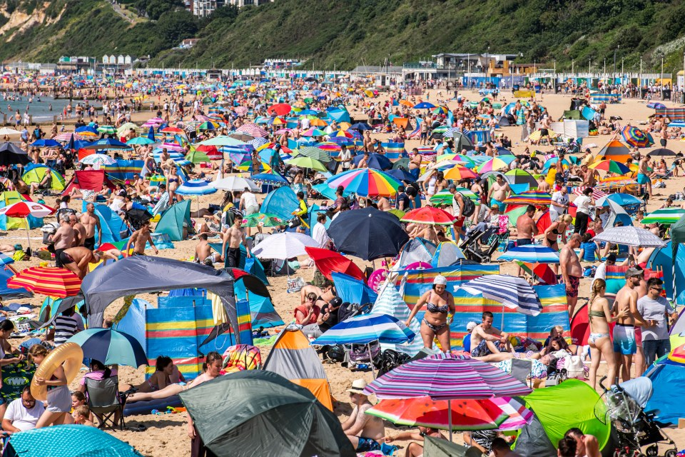 Thousands of people are basking by the sea in Bournemouth