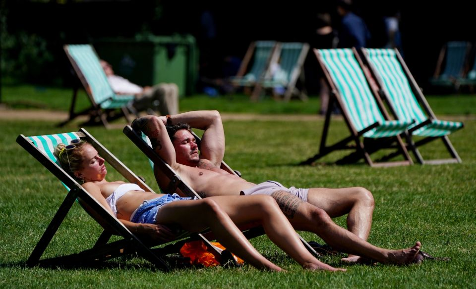 Visitors relax on deckchairs set up in Green Park, London