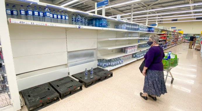 A shopper views the sparse selection at Tesco in Bathgate, West Lothian