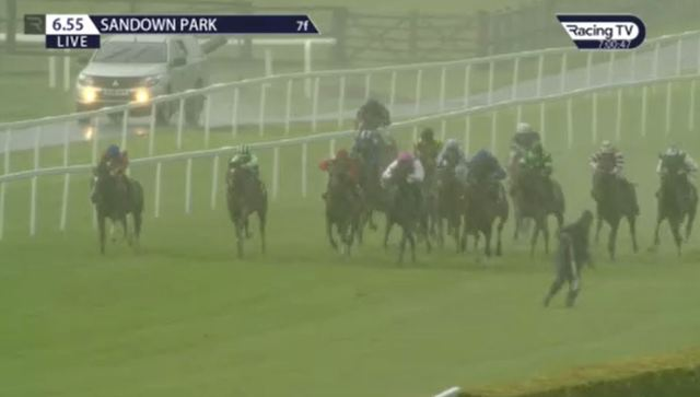 The horses are barely yards away when the man finally springs into action