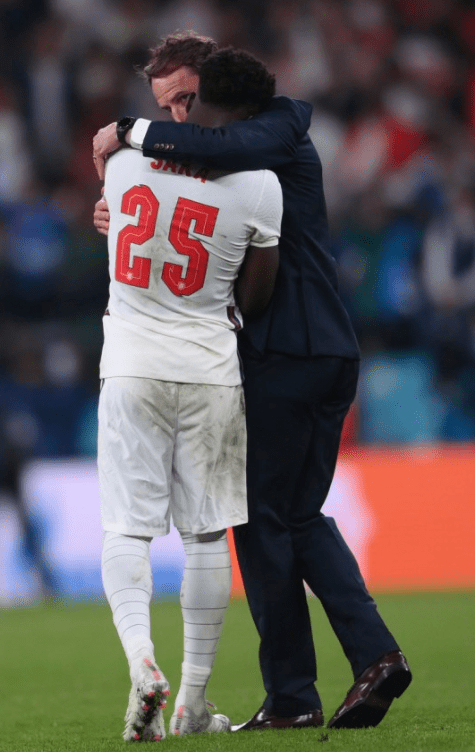 Gareth Southgate knows just how Bukayo Saka feels as he tries to comfort the England sub after his penalty miss