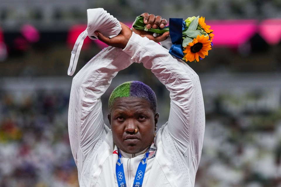 Raven Saunders raised her arms to make an X symbol on the podium