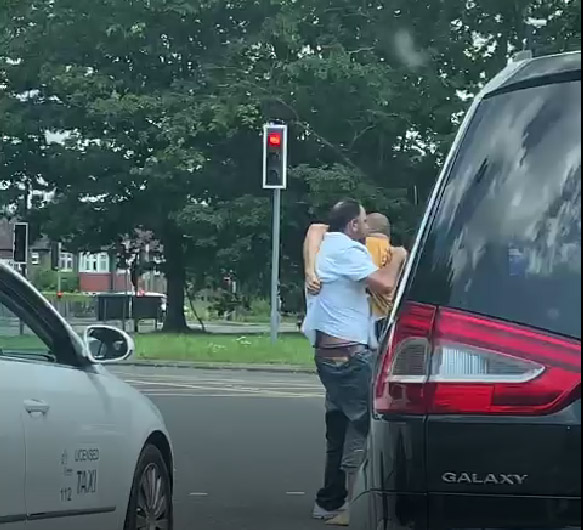 The shocking brawl happened after the Mayor was cut up at a busy roundabout