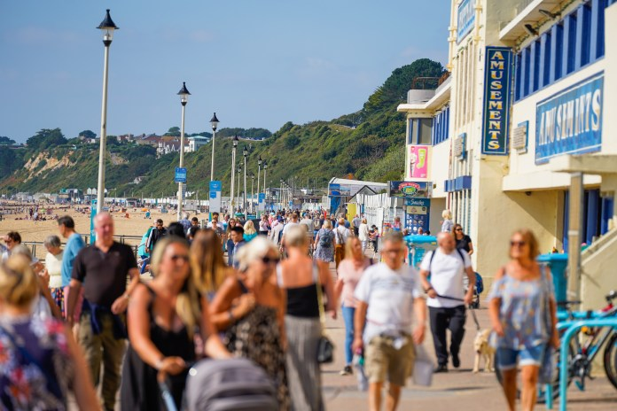 Thousands of people flocked to the South Coast today to make the most of the weather