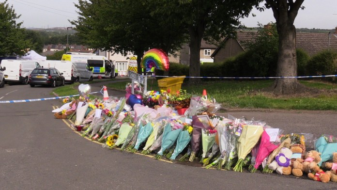 A sea of wreaths rise near the scene at Kilmarsh, Chandos Crescent, near Sheffield