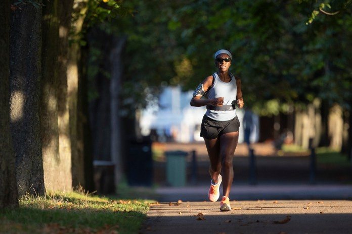 A jogger out for running in Greenwich Park in south east London