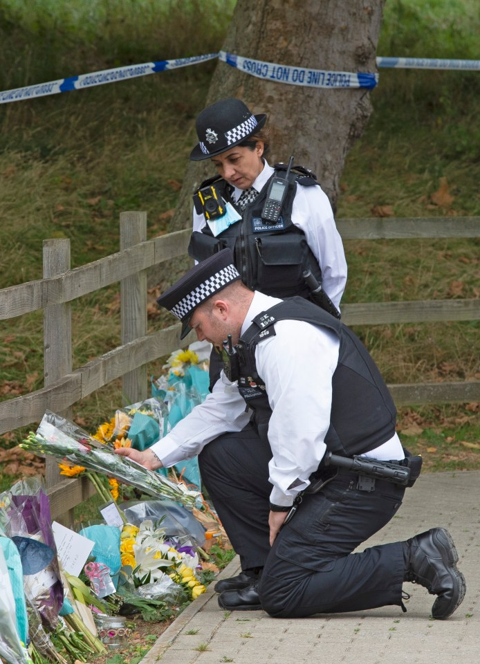 The officials showered flowers from the mourners at the site of the incident.