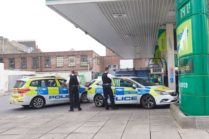 Police officers jump in queue on the A10 in Hackney, London