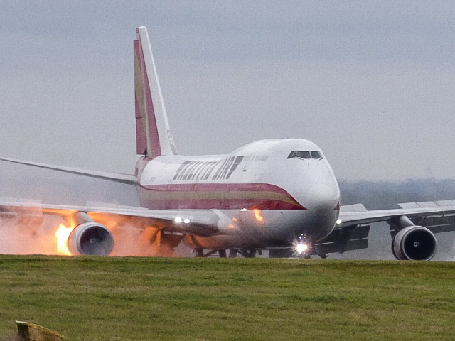 The right hand side of the plane could be seen in orange flames as the aircraft touched down on the tarmac