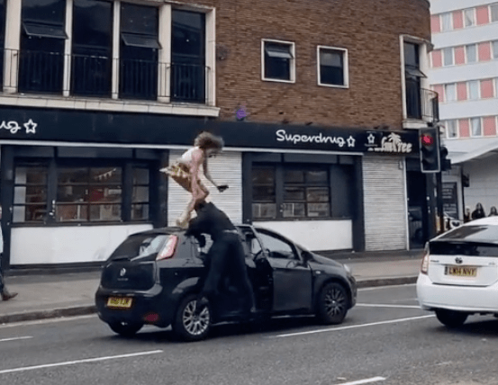 The woman was sent flying to the road after the driver punched her
