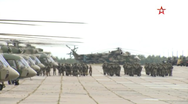 Troops preparing some of the 80 warplanes and helicopters being used in the drills