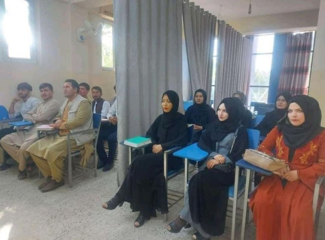 Women and men have been separated by a curtain at a university in Kabul