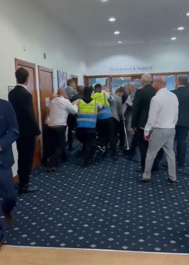 Security scuffles with racegoers in desperate bid to break up scuffle