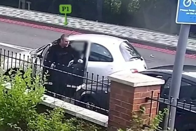 Men streamed out of a grey car and quickly surrounded Thomas' vehicle
