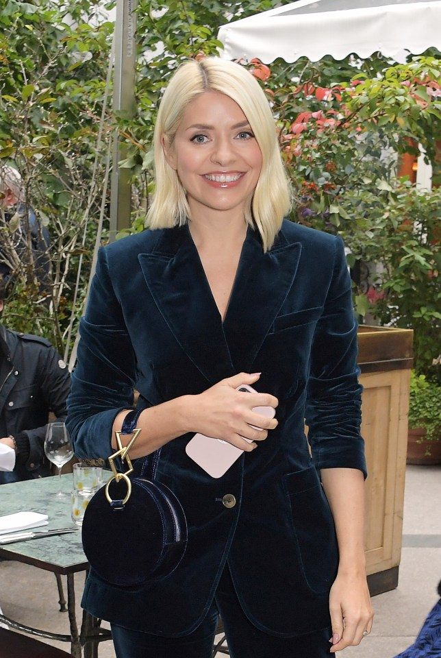 The presenter looked happier than ever as she posed for photos at the event