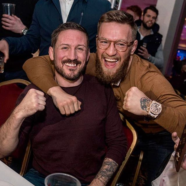 McGregor pictured the day before with Coach John Kavanagh