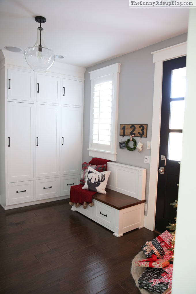 Mudroom with builtin cabinets decked for Christmas  The