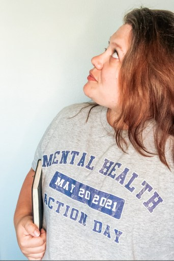 Mental Health Action Day Tee Shirt modeled by Summer The Sunshine Suitcase
