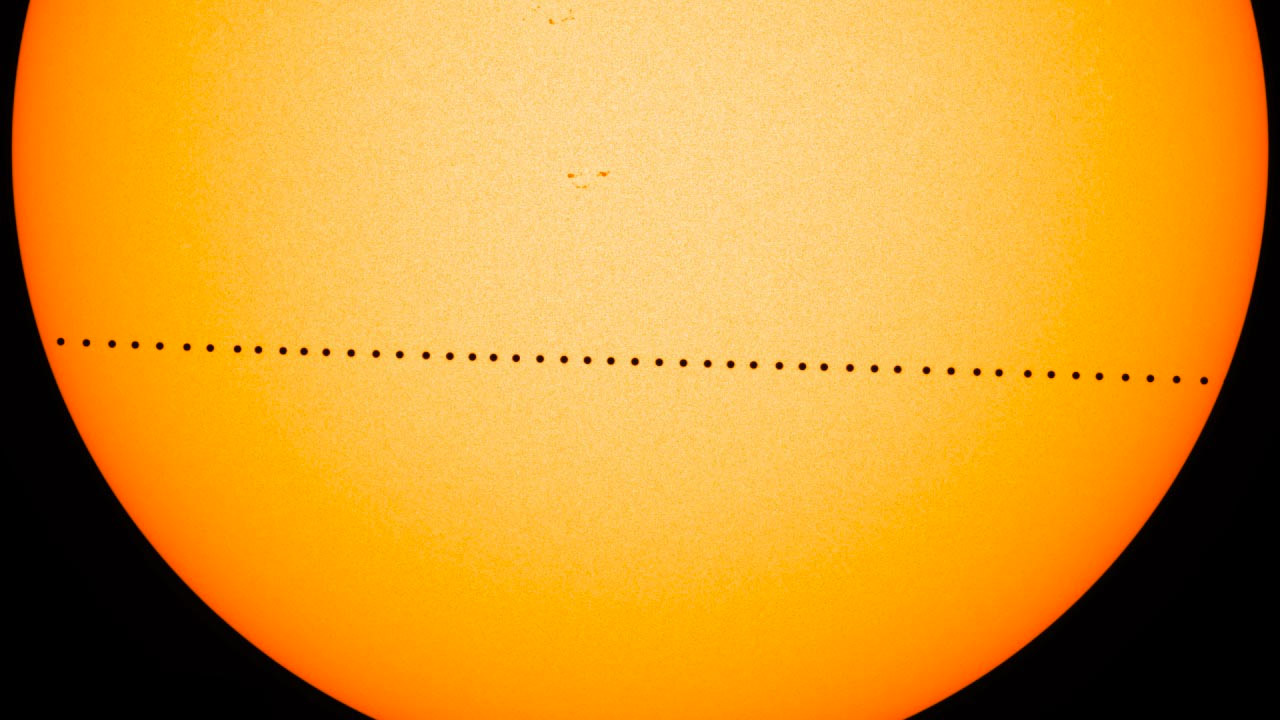 Composite image of Mercury transiting across the sun on May 9, 2016, as seen by HMI on NASA's Solar Dynamics Obersvatory. HMI is an instrument designed to study the magnetic field at the solar surface, or photosphere. Credit: NASA/SDO
