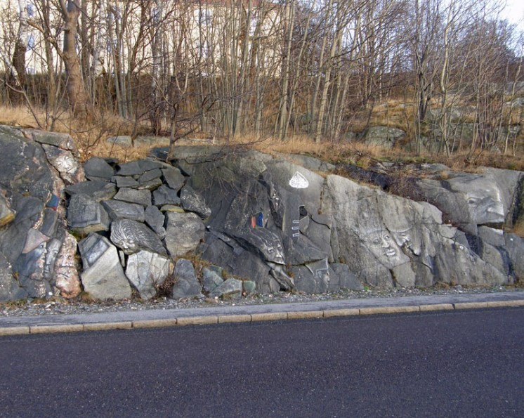 On the bare rock by the side of the road - faces