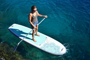 Woman on Isle Airtech 10 4 Yoga Paddleboard