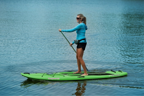 female paddling a sun dolphin seaquest sup