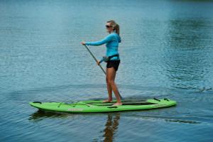 women paddling on Sun Dolphin Seaquest paddle board