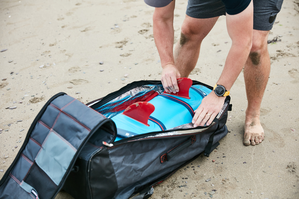 Red paddle co snapper youth SUP backpack and fins