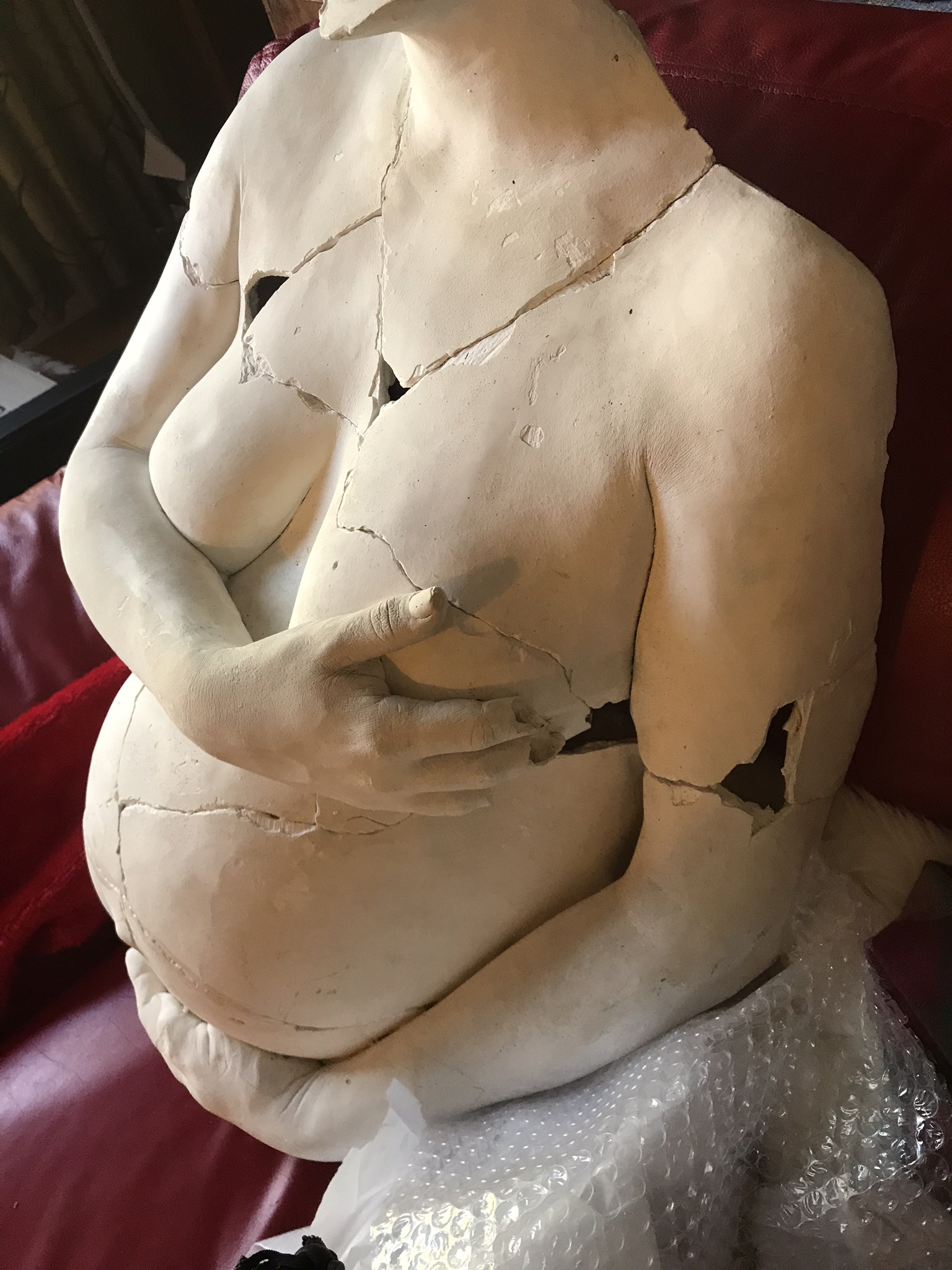 body cast of pregnant woman broken and reassembled