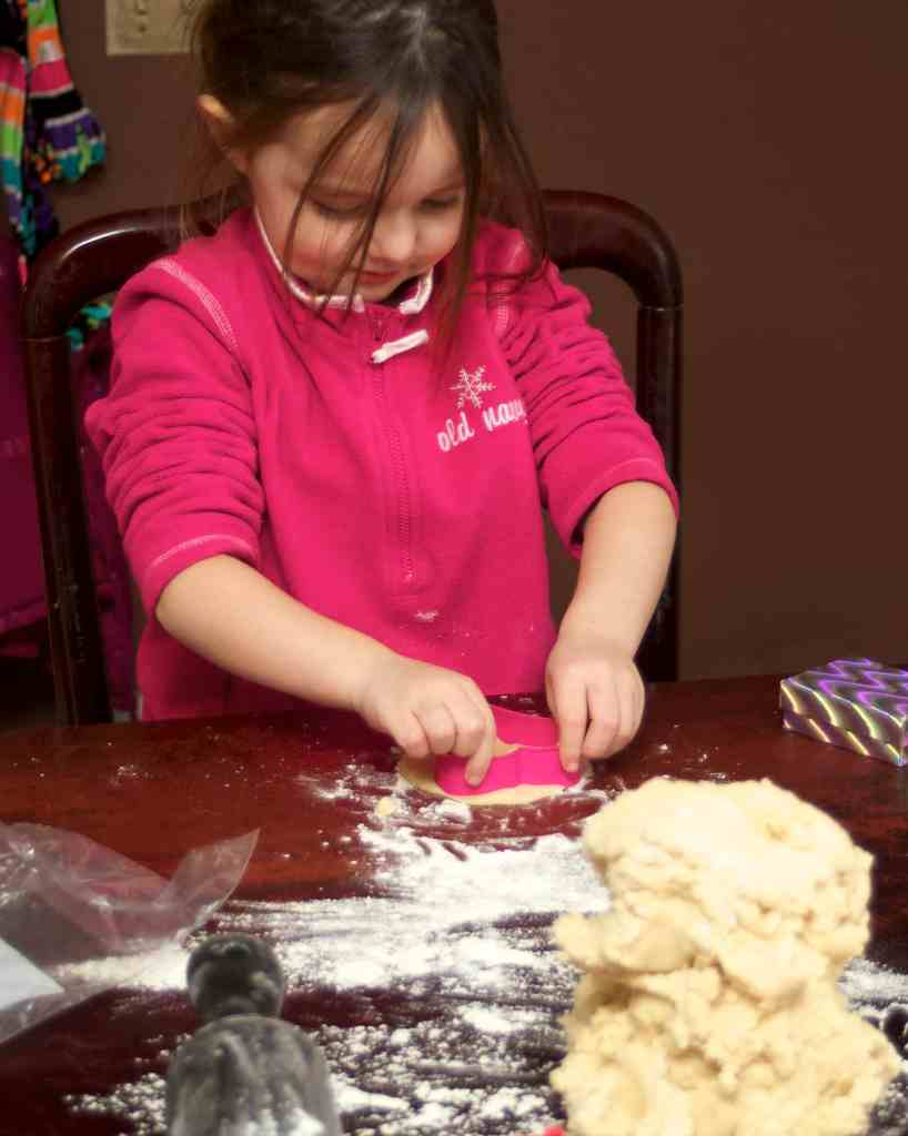 cutting out heart cookies