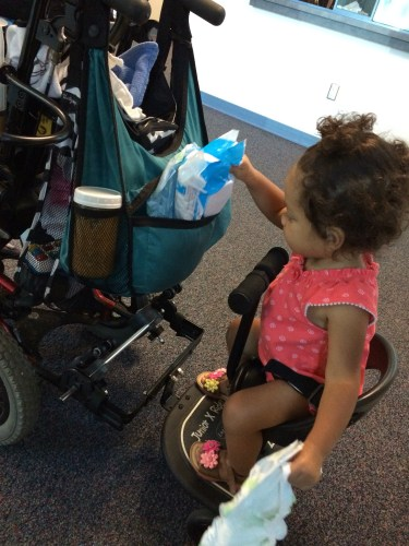 one child uses a wheelchair and the other a stroller
