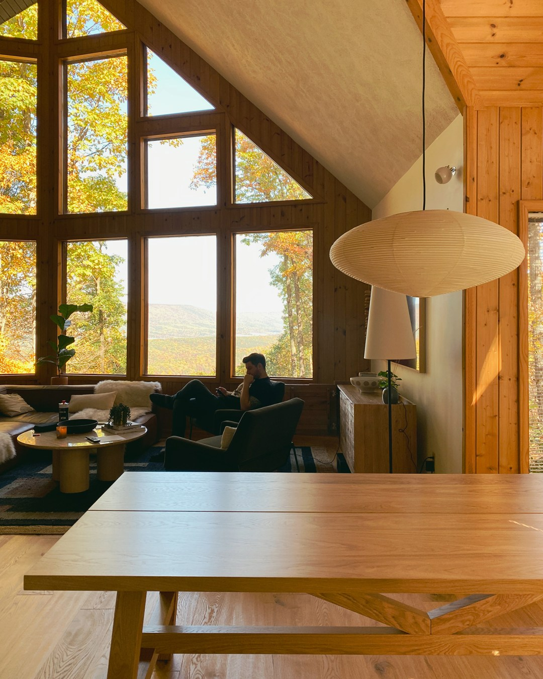 Cabin view with mockelby dining table and noguchi pendant