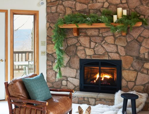 Stone fireplace with holiday garland