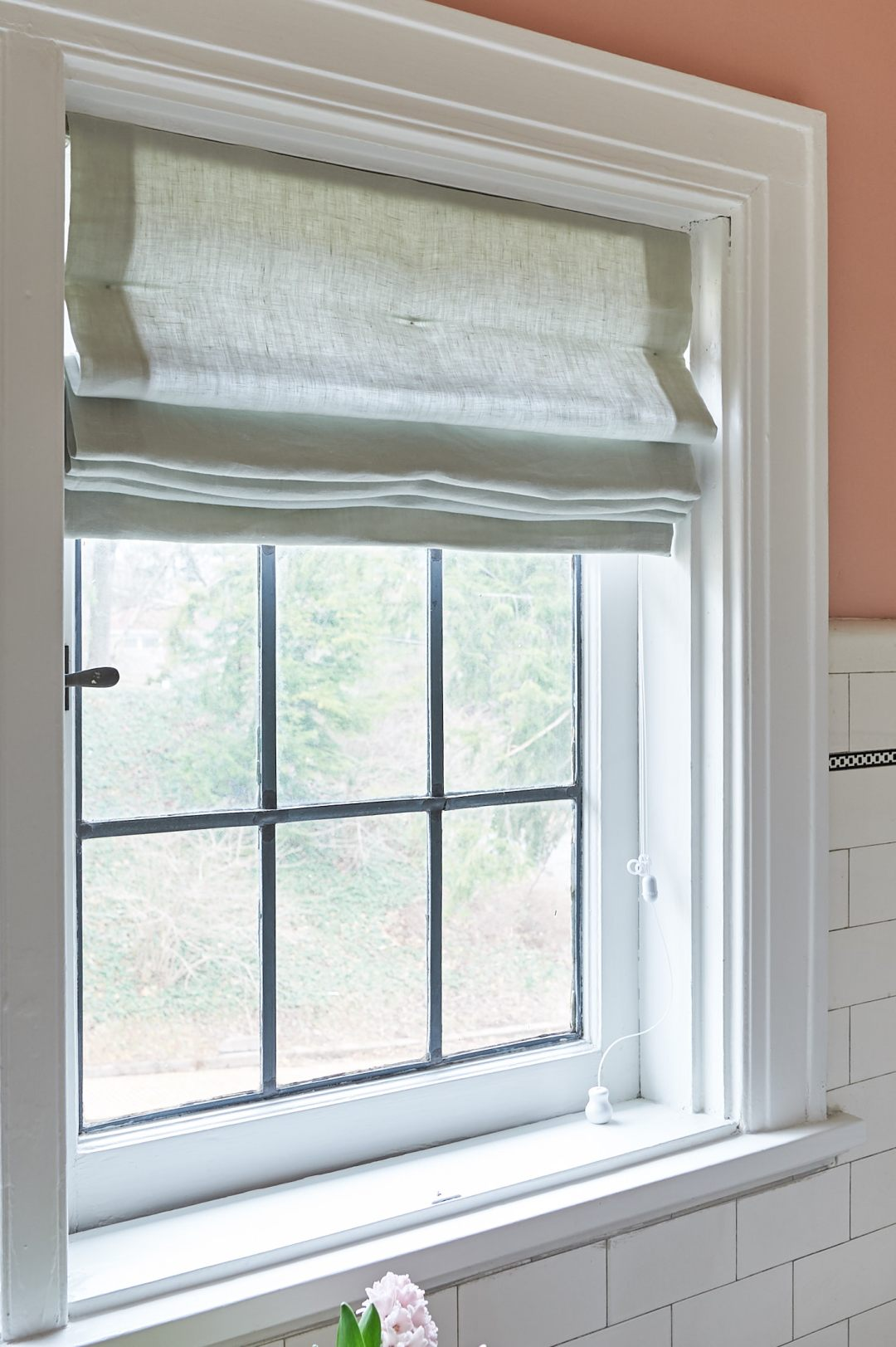 Linen roman shades with leaded glass window