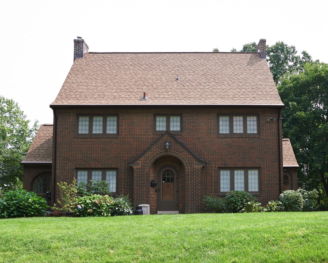 Brick house exterior with SW Black Fox trim.