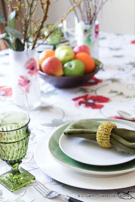 Feel the warmth of this mid-summer tablescape that is awash with bright colors and flowers.