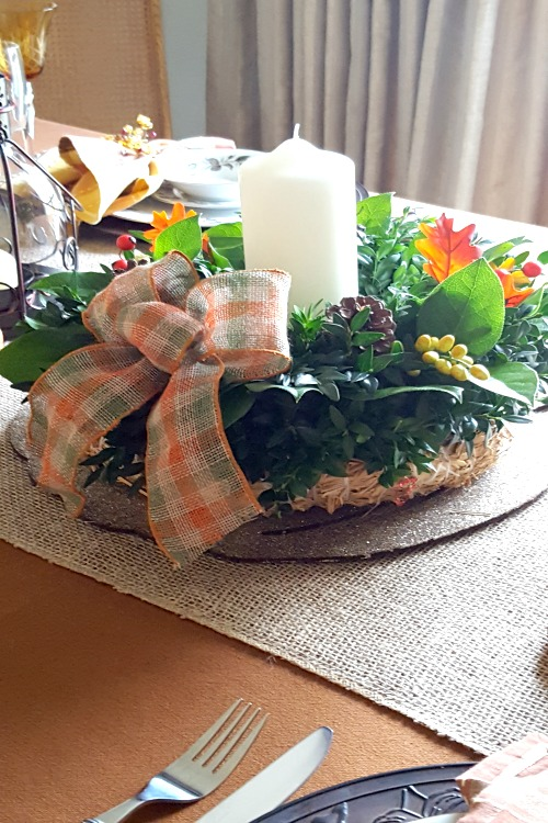 I chose a foliage and burlap Thanksgiving tablescape for its simplicity and to extend the life of the centerpiece.