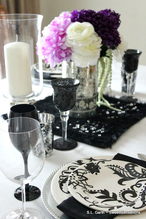 This Ebony and Ivory Tablescape with a Pop of Purple served to brighten the room after a string of overcast days.