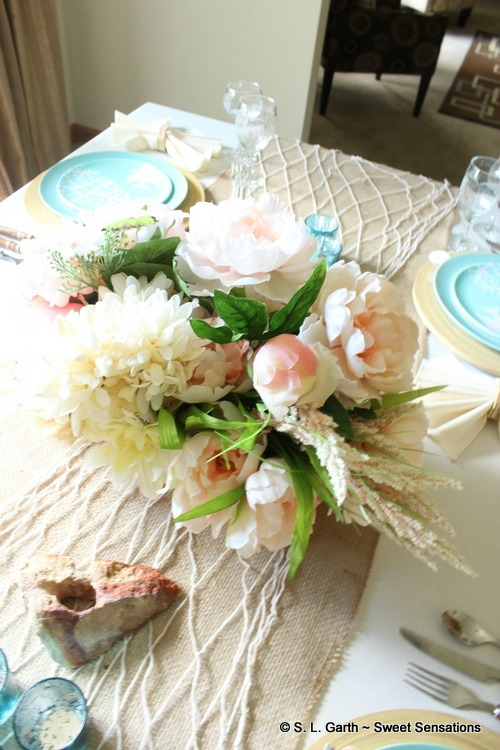 This tropical/beach theme tablescape set the tone for our 41st-Anniversary celebration.