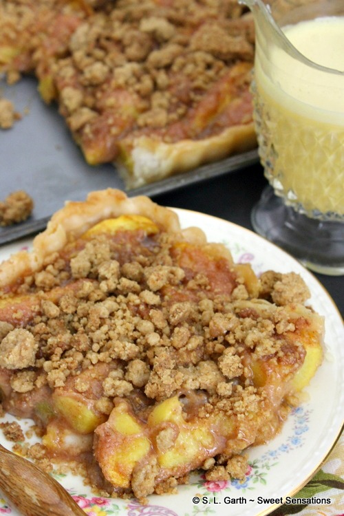 This Peach Crumble Tart can be made in a standard pie pan using homemade or a pre-made pie crust. Serve it plain or with a melted vanilla ice cream sauce.