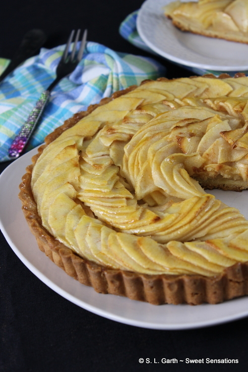 Tarte aux Pommes is a classical French apple tart. Thinly sliced apples are laid in circles and brushed with warm apricot jam.